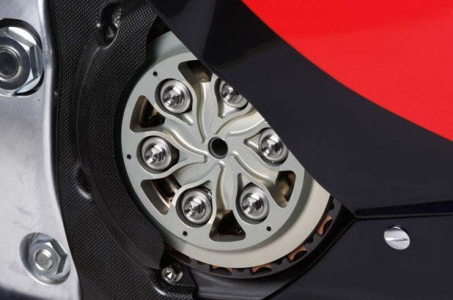 Honda Denies Using DCT in MotoGP   Admits to Having New Faster Shifting Transmission 2011 Honda RC212V clutch close 635x421