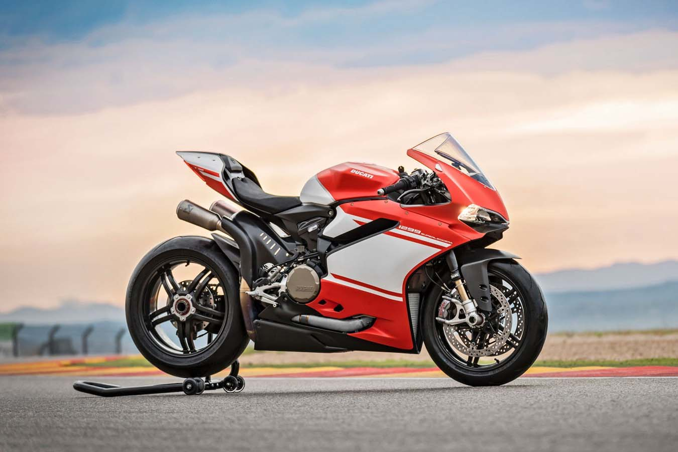 watch the ducati 1299 superleggera shred a race track